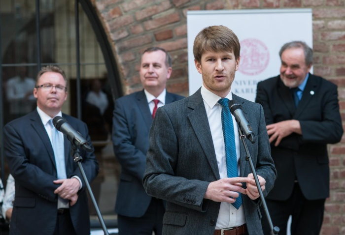 Historian Jakub Jareš speaking at the opening of the exhibition.